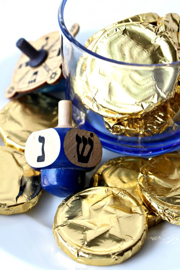 Gold foil wrapped chocolate coins with a blue dreidle