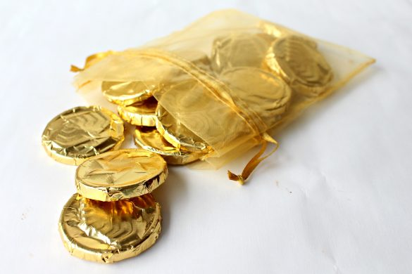 Chocolate Coins  spilling out of a gold mesh bag