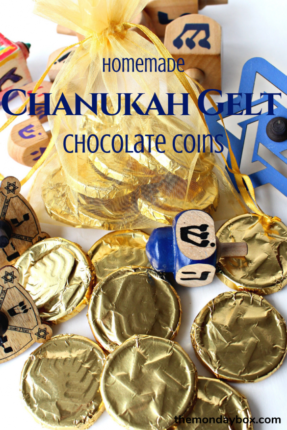 gold foil covered chocolate coins with a dreidle