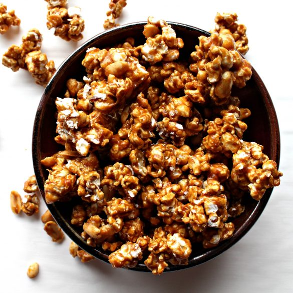 Caramel Popcorn in clusters with caramel coated peanuts.
