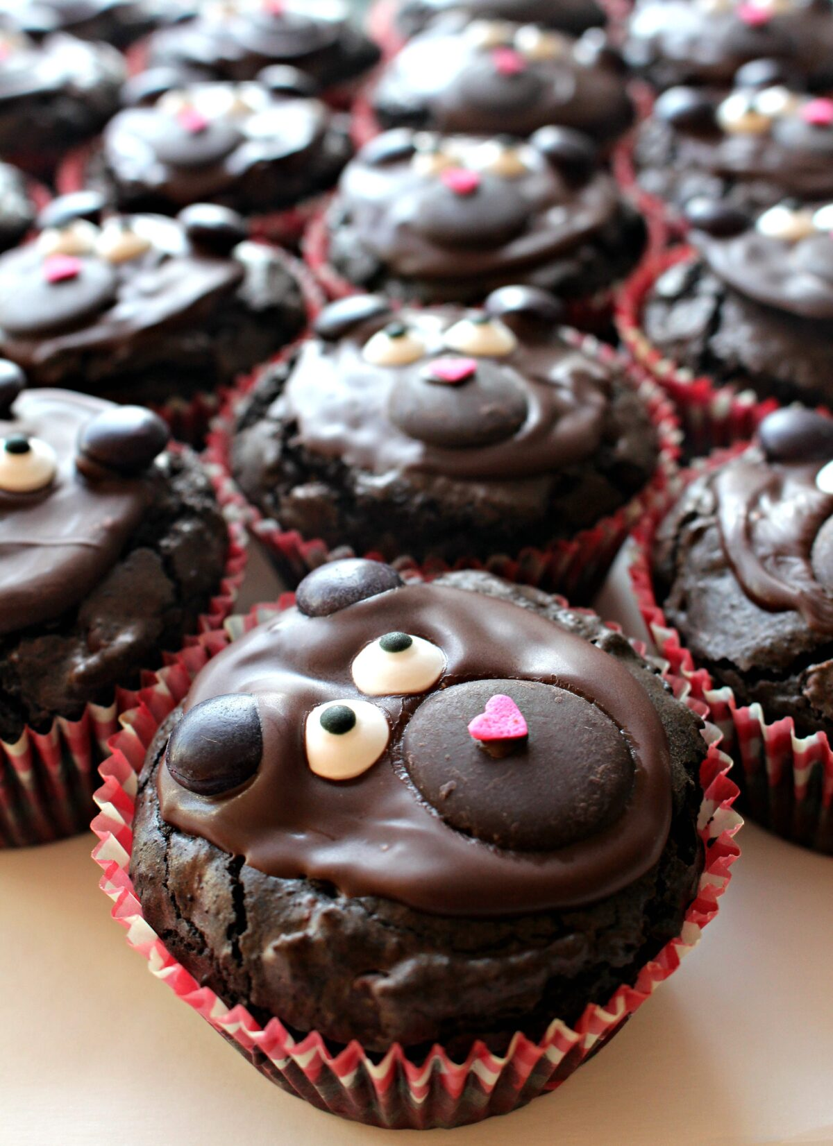 Close up of a brownie bear cupcake.