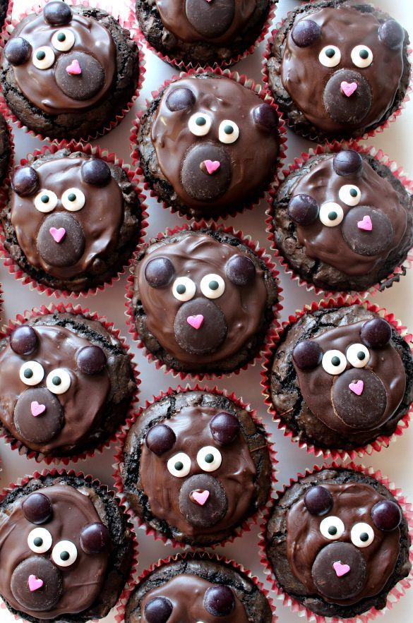 Beary Chocolate Brownie Bears are cupcake shaped brownies decorated with chocolate and sprinkles to look like the face of a bear.