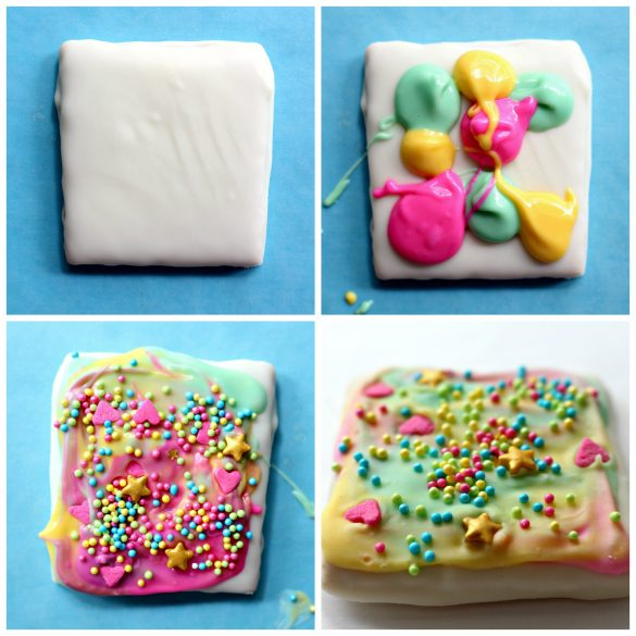 Four photos showing the steps to decorating Unicorn Sprinkle Chocolate Covered Graham Crackers. Photo #1 : Graham cracker square coated in white chocolate. Photo #2: teaspoon fulls of colored white chocolate (green, yellow, pink) randomly plopped on the coated cracker. Photo #3 : The colored chocolate is swirled to cover the surface, then sprinkled with pastel nonpareils, pink hearts, and gold stars. Photo #4: Closeup of sprinkles on top of the swirled pastel colored chocolate.