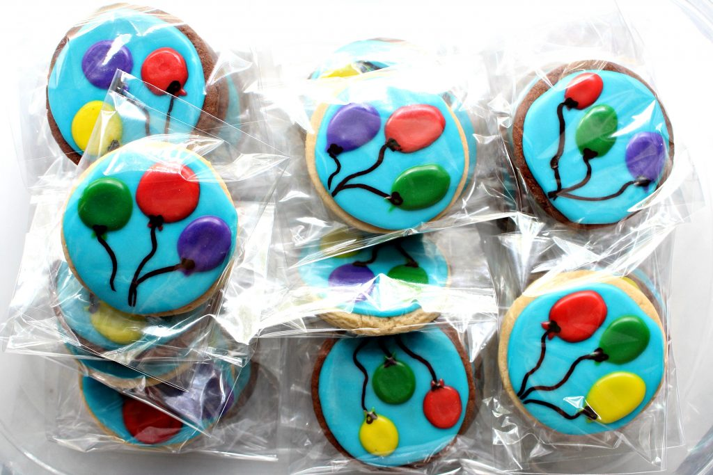 Balloon Sugar Cookies wrapped in individual cellophane bags for gift giving.
