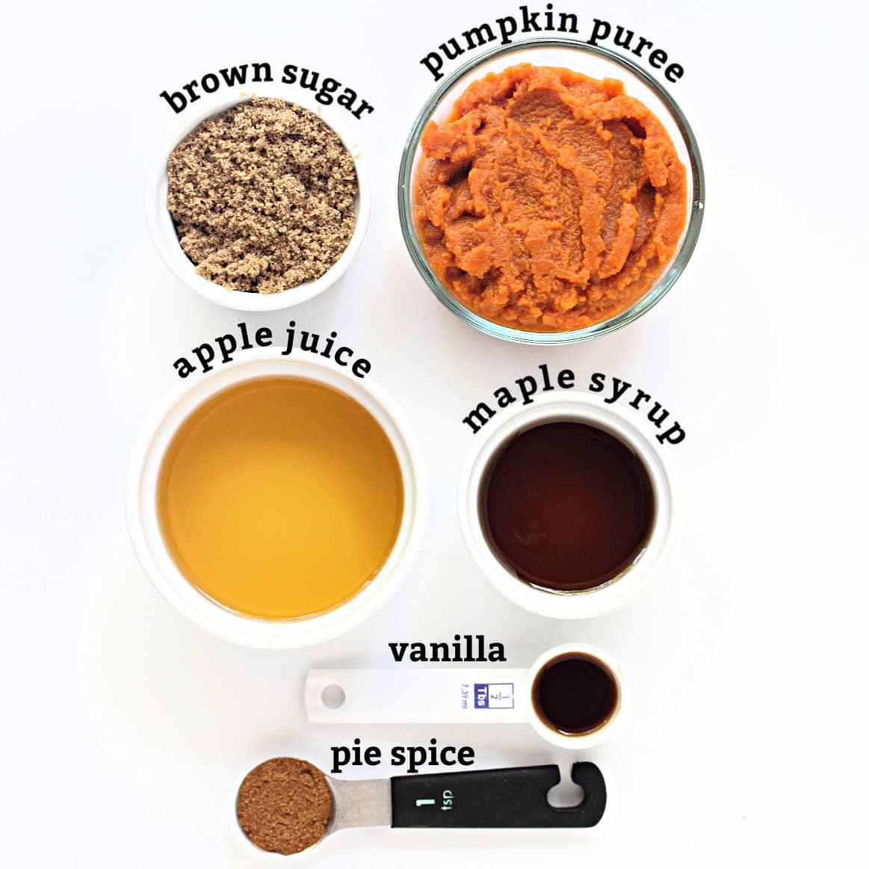 Pumpkin butter ingredients; brown sugar, pumpkin puree, apple juice, maple syrup, vanilla, pumpkin spice.