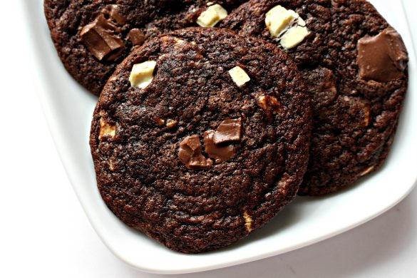 Closeup of chocolate cookies with melted chunks of white and milk chocolate on top