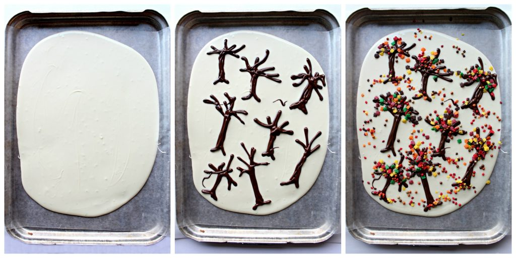 Thanksgiving White Chocolate Bark in 3 steps. Step 1 make large oval with melted white chocolate. Step 2 pipe on tree trunks with branches using melted dark chocolate. Step 3 Add fall colored leaf and nonpareil sprinkles.