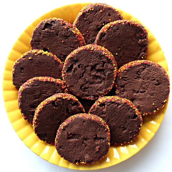 sliced Spiced Chocolate Shortbread Cookies on a bright yellow plate.