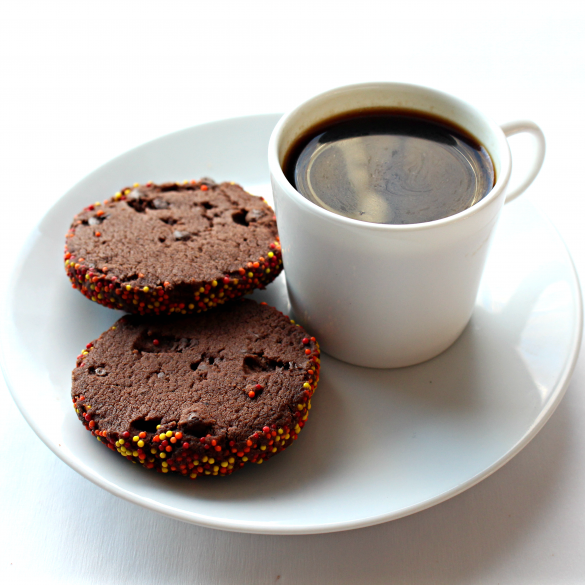 Spiced Chocolate Shortbread Cookies next to a cup of espresso.