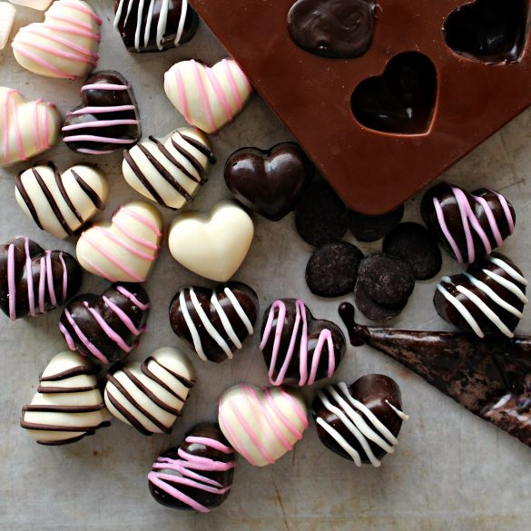 Chocolate Marshmallow Hearts outside of mold in dark and white chocolate with pink or chocolate stripes