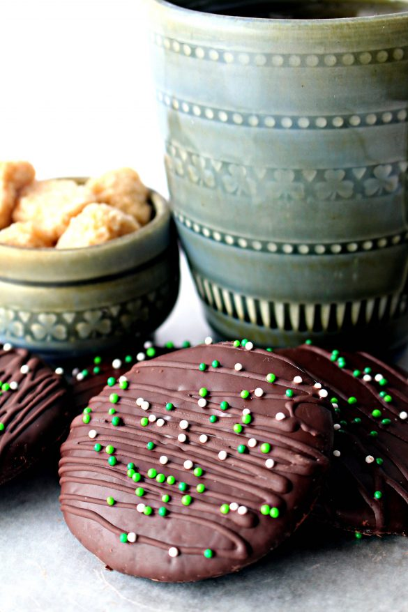 Chocolate Covered Chocolate Mint Cookies in front of a gray Irish porcelain coffee mug
