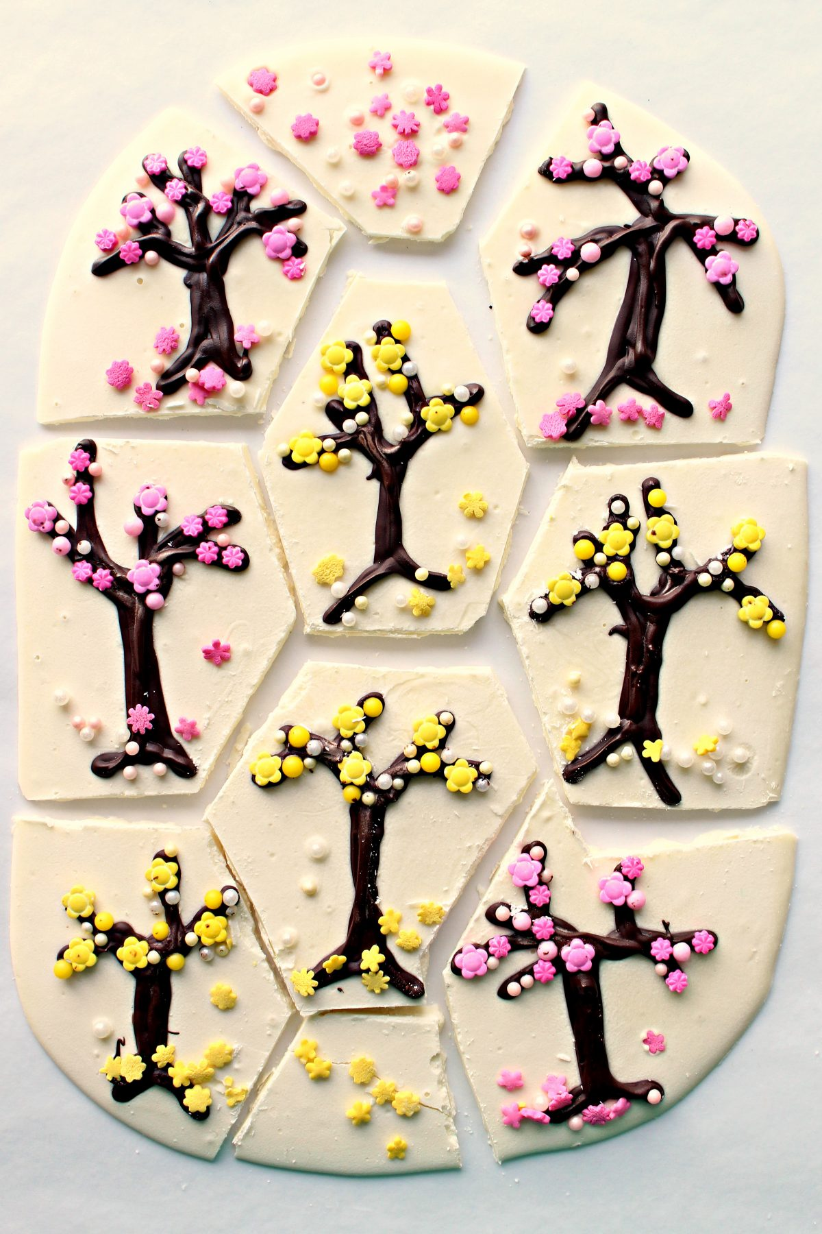 Chocolate Bark cut into pieces so that each serving includes one decorated tree design.