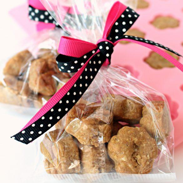 Paw Prints Dog Cookies wrapped in bag with pink and black ribbon