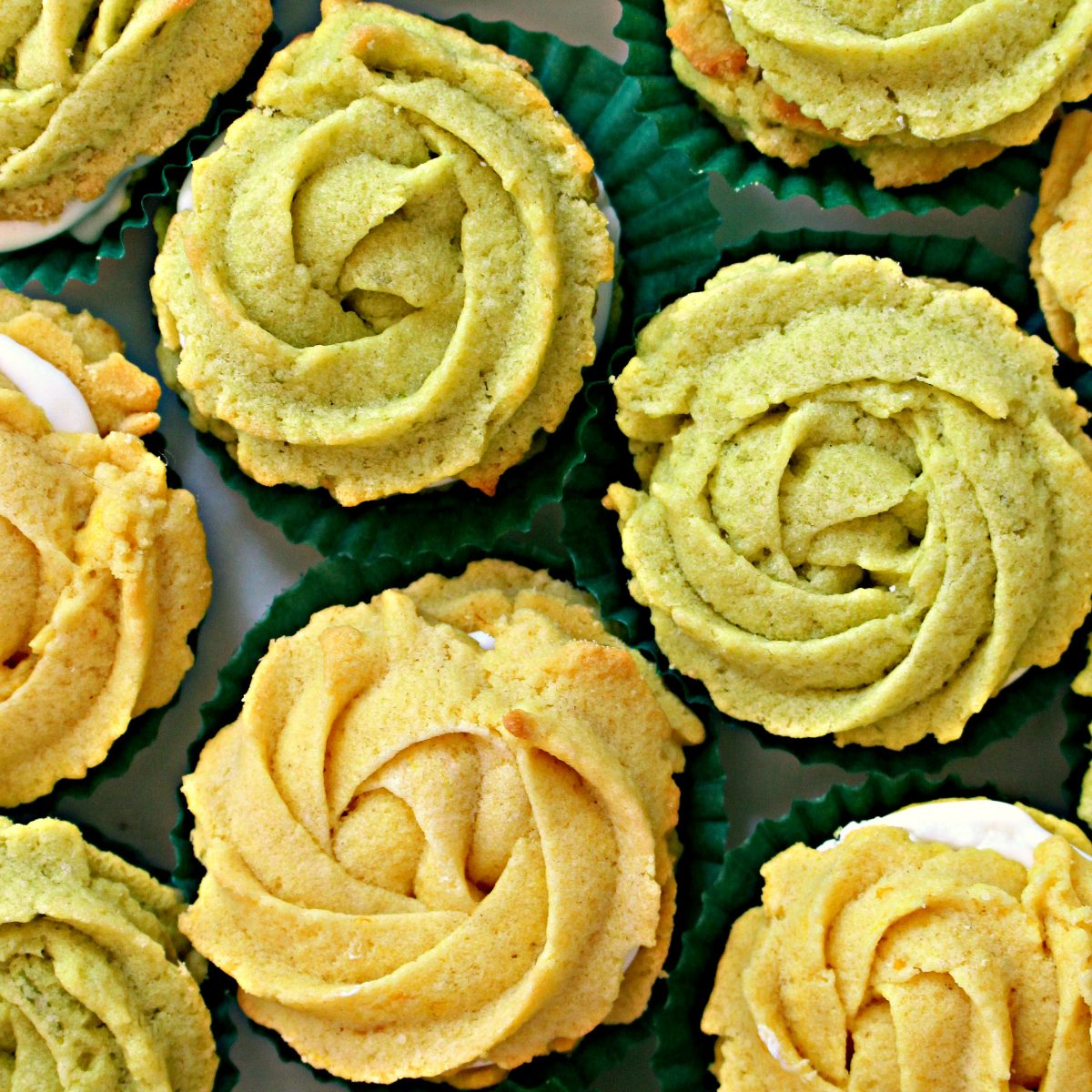 Lemon and Lime Butter Cookie Rosettes in dark green cupcake papers.