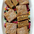 7 Root Beer Float Bars on a white platter with colorful licorice candies