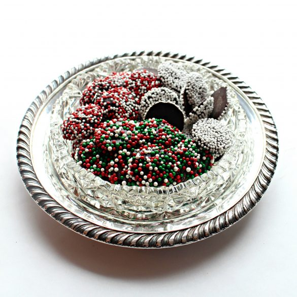 A variety of colors of Nonpareil Candies in a silver and crystal candy dish.
