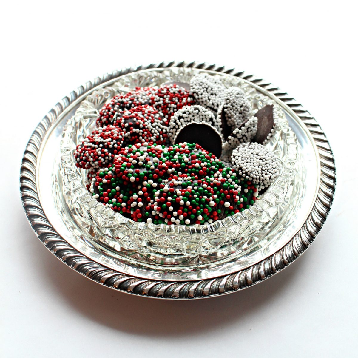 Candies in a silver and crystal candy dish.