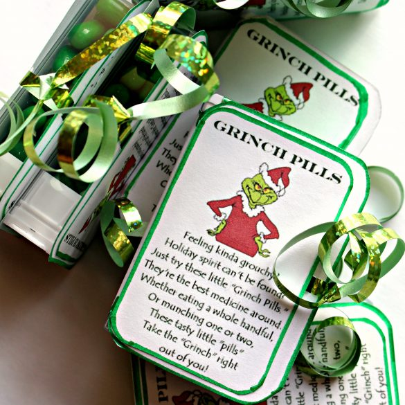 A poem describing Grinch pills glued to a TicTacs box and tied with a green ribbon.