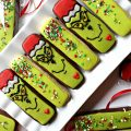 Diagonal photo of Decorated Grinch Cookies and Green Sprinkled Cookies on a white platter.