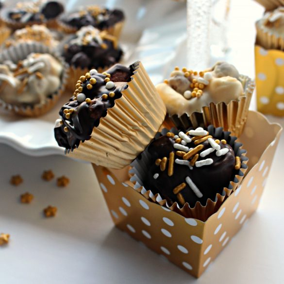 Two No Bake Chocolate Peanut Butter Cookies in a gold with white polka dot candy cup