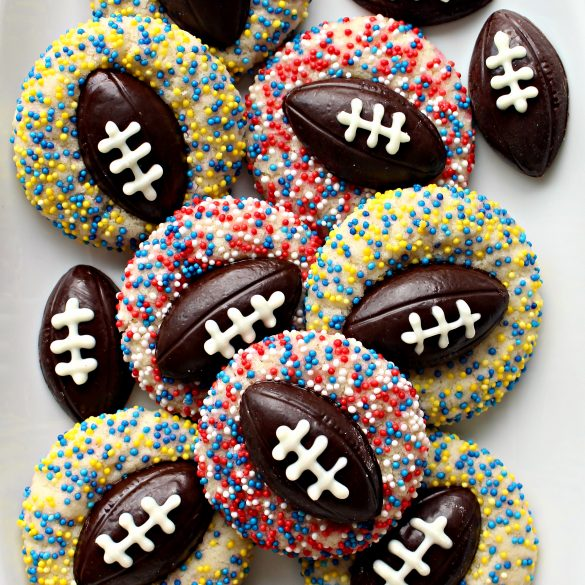 Shortbread Thumbprint Cookies with chocolate football centers and team colored sprinkles