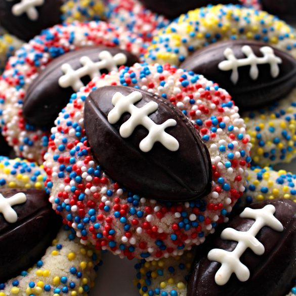 Shortbread Thumbprint cookie with chocolate football and red white and blue sprinkles