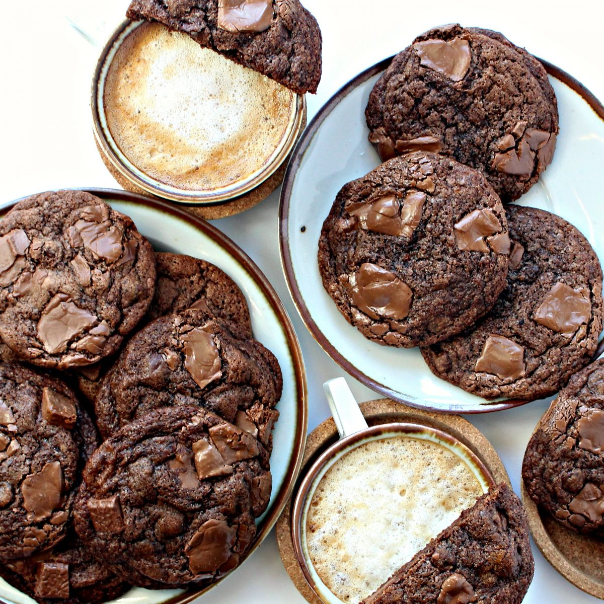 Chocolate Chip Mocha Cookies on plates with coffee cups.