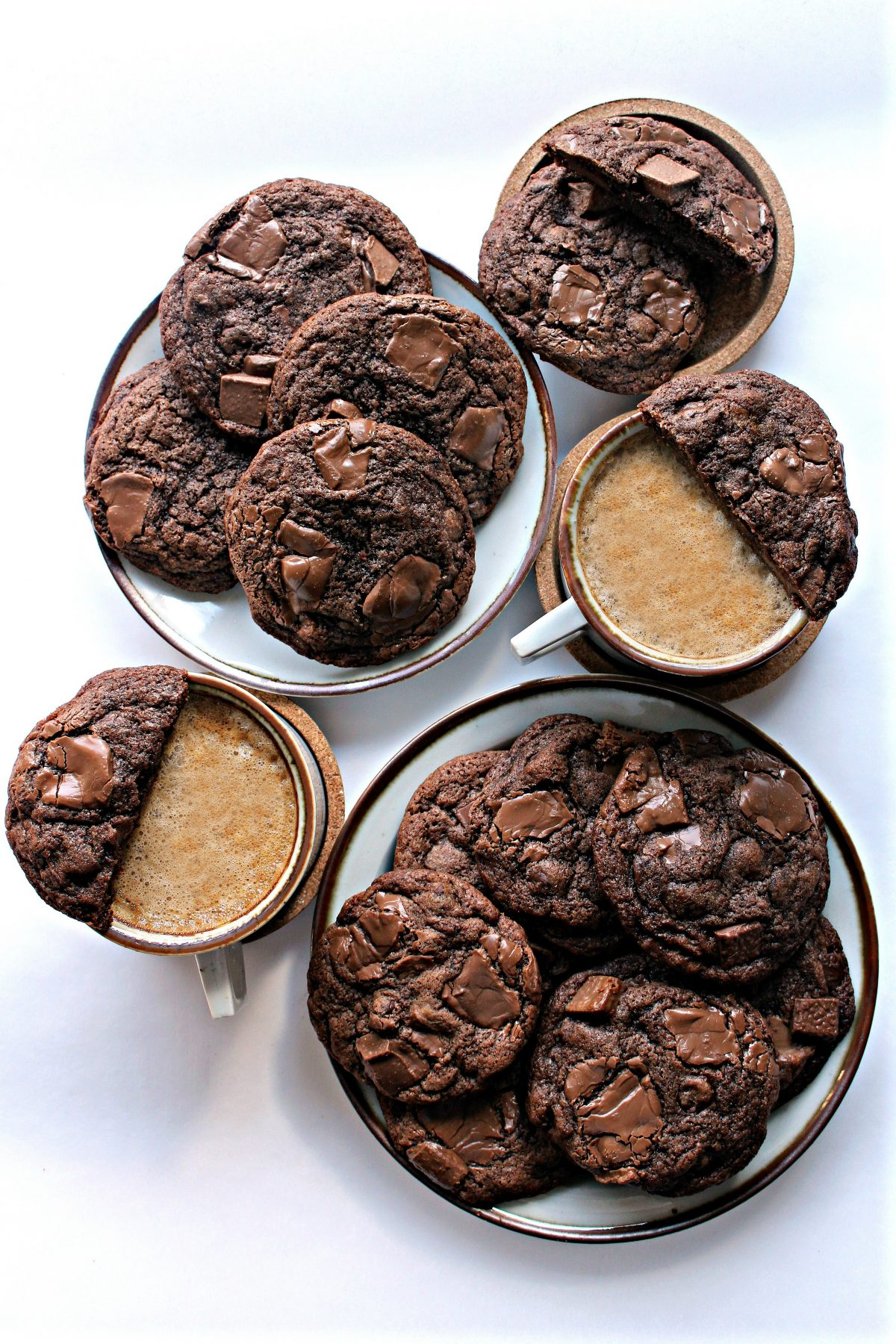 Chocolate Chip Mocha Cookies on plates with two cups of coffee.