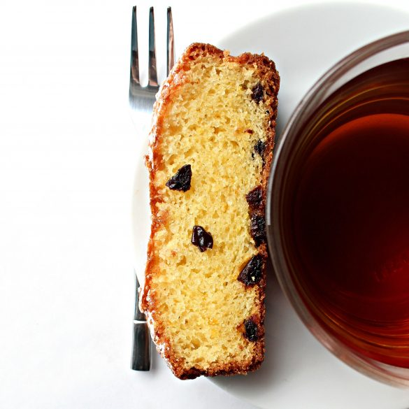 Slice of Orange Olive Oil Cake with a cup of tea