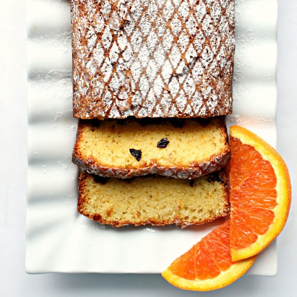 Closeup of Orange Olive Oil Cake sliced on a platter
