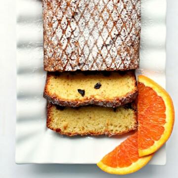 Closeup of Orange Olive Oil Cake sliced on a platter