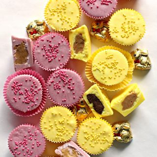 Yellow and pink peanut butter cups with mathing sprinkles