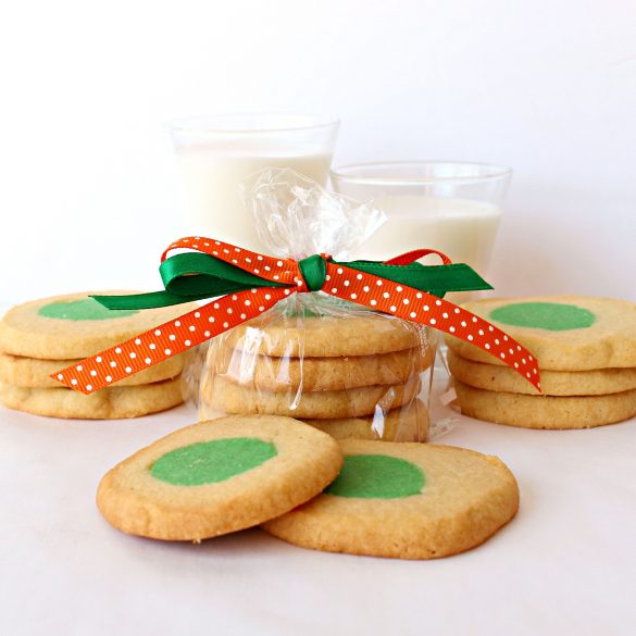 Green Eggs and Ham Cookies in a plastic bag tied with green and orange ribbon