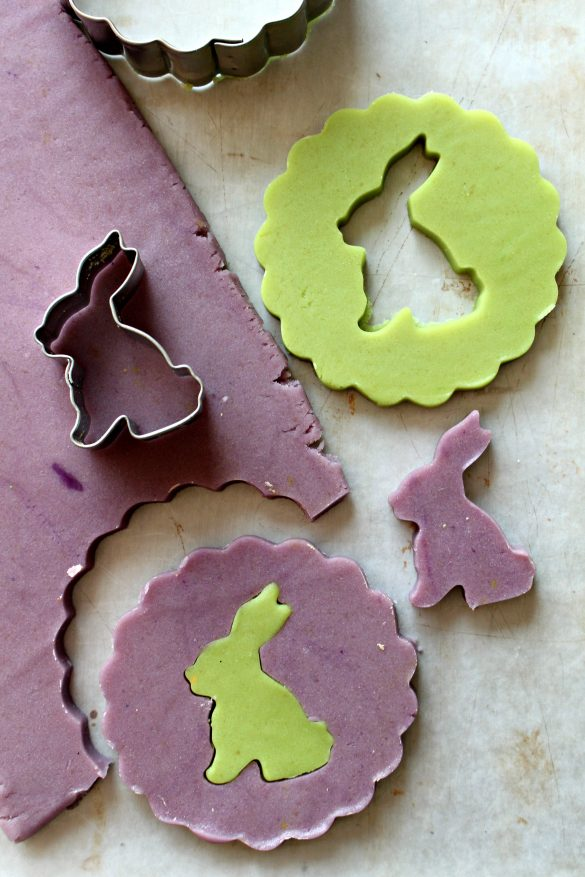 cookie cutters and rolled out dough for cutting out cookies and rabbit silhouettes
