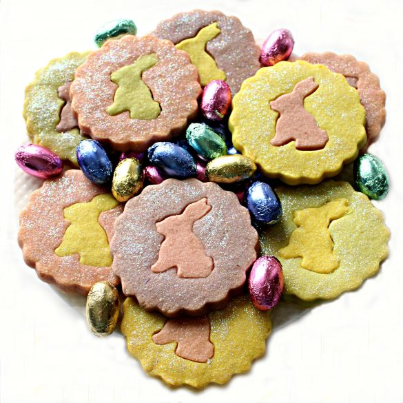 Pastel colored circle shortbread cookies with contrasting bunny centers on a plate