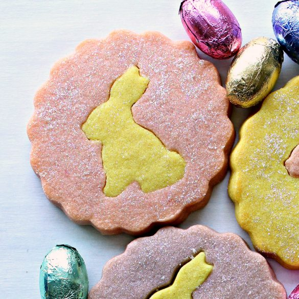 Pink cookie with yellow bunny center sparkling with edible glitter