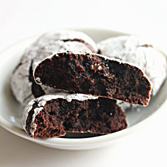 cakey interior of Chocolate Crinkle Cookie with melted chocolate chips