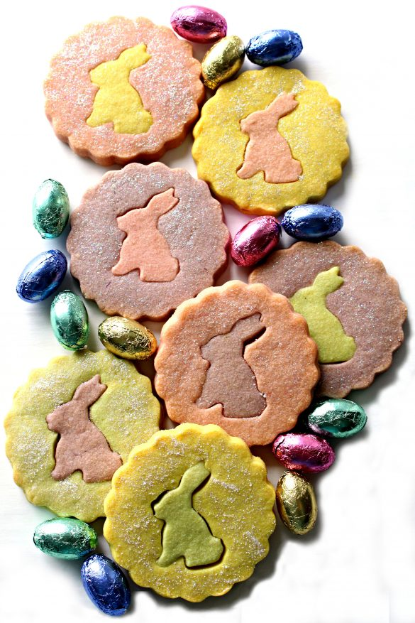 Pastel colored shortbread cookies with rabbit silhouette cutout centers
