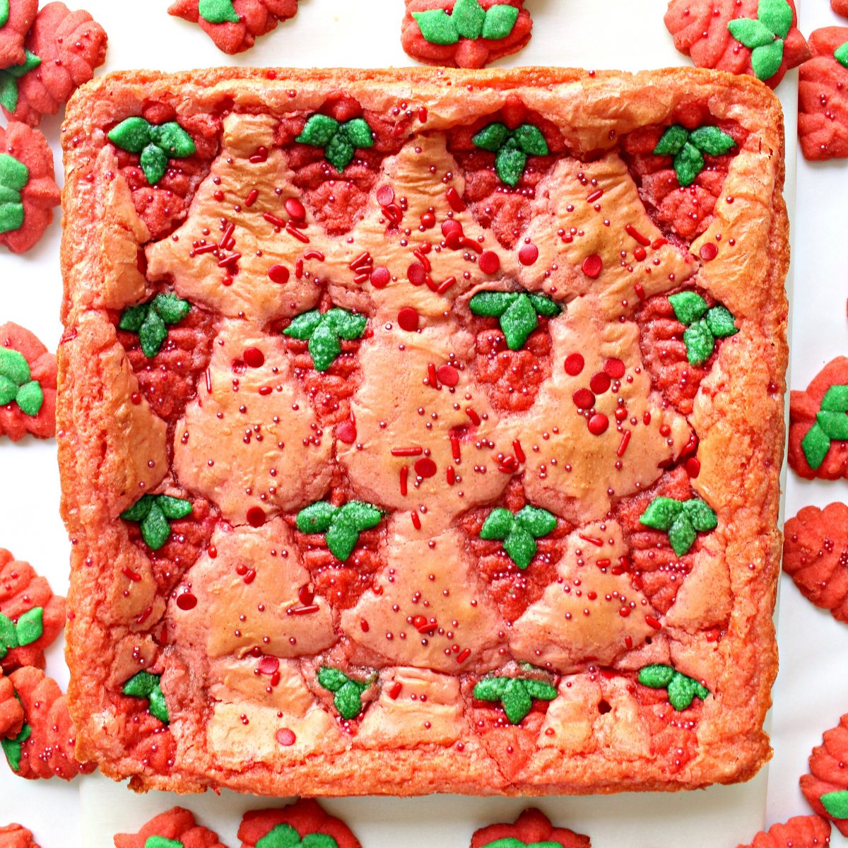 Uncut pan of Strawberry Brownies with Strawberry Press Cookies baked on top for decoration.