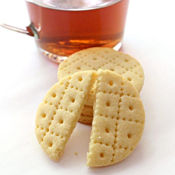 tea cup in background, Shrewsbury Biscuit broken in half on grid line in the foreground