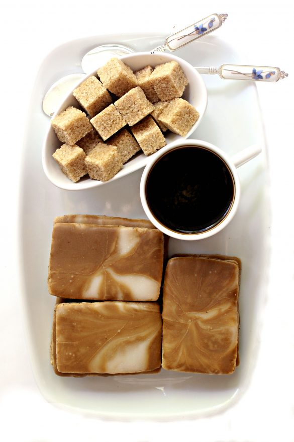 Cofee Cookies on white rectangle platter with a bowl of brown sugar cubes, a white mug of coffee, and two silver spoons