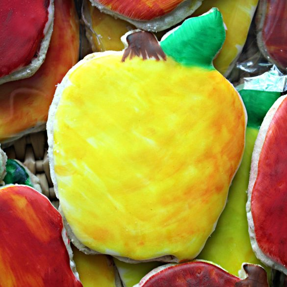 Yellow apple shaped cookie with red shading on the right side
