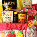 Rosh Hashanah gift care package box filled with homemade and purchased gifts with apples and honey flavors.