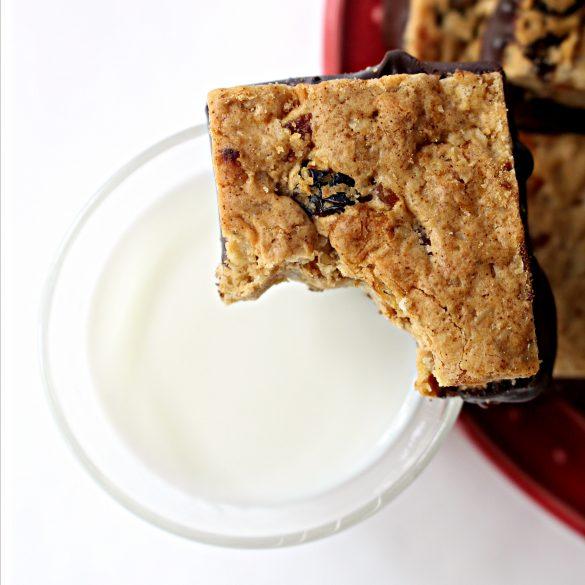 Oatmeal Fruit Bar on rim of glass of milk