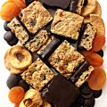 arrangement of Oatmeal Fruit Bars, dried apricots, chocolate discs, and dried apples