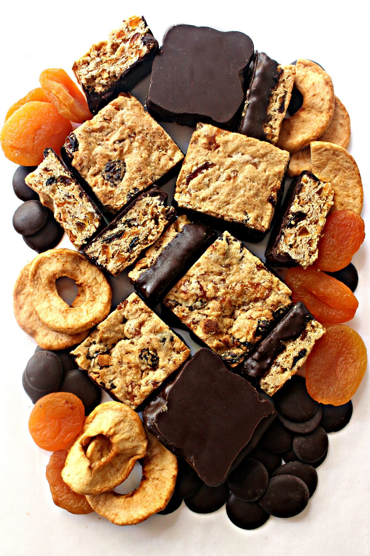 Oatmeal Fruit Bars surrounded by dried fruit and chocolate discs