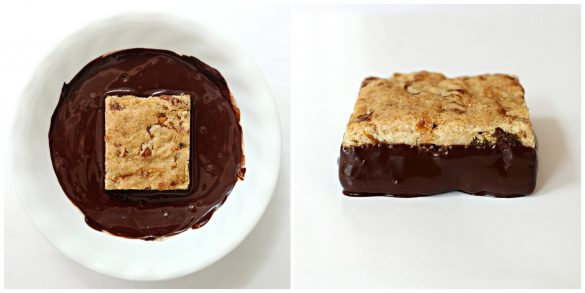 bar in bowl of melted chocolate, bar showing bottom half coated in chocolate