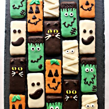 Chocolate coated graham Crackers decorated as Frankenstein, Pumpkin, Ghost, Mummy, and Cat.