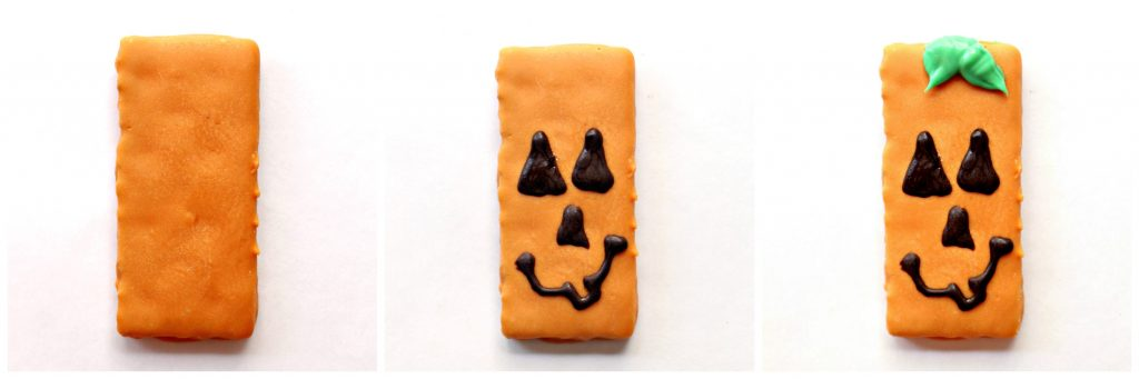To make Spooky Graham Crackers pumpkins: 1. coat graham in orange colored white chocolate 2. pipe on dark chocolate eyes, nose, and mouth 3. pipe on green colored white chocolate leaves at top of cookie