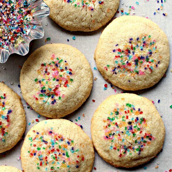 Closeup of Vanilla Bean Shortbread Cookies with multicolored sugar sprinkles.